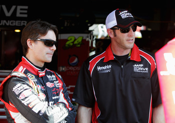TALLADEGA, AL - OCTOBER 05:  (L-R) Jeff Gordon, driver of the #24 Drive to End Hunger Chevrolet, talks with crew chief Alan Gustafson in the garage during practice for the NASCAR Sprint Cup Series Good Sam Roadside Assistance 500 at Talladega Superspeedwa