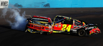 AVONDALE, AZ - NOVEMBER 11:  Clint Bowyer, driver of the #15 5-hour Energy Toyota, and Jeff Gordon, driver of the #24 DuPont Chevrolet, collide on track during the NASCAR Sprint Cup Series AdvoCare 500 at Phoenix International Raceway on November 11, 2012