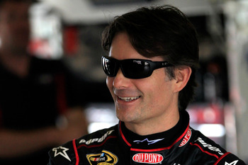 HOMESTEAD, FL - NOVEMBER 16:  Jeff Gordon, driver of the #24 DuPont 20 Years Celebratory Chevrolet, stands in the garage during practice for the NASCAR Sprint Cup Series Ford EcoBoost 400 at Homestead-Miami Speedway on November 16, 2012 in Homestead, Flor