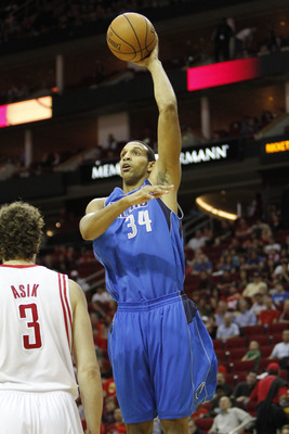 Dec 8, 2012; Houston, TX, USA; Dallas Mavericks center Brandan Wright (34) takes a shot against the Houston Rockets in the first quarter at the Toyota Center. Mandatory Credit: Brett Davis-USA TODAY Sports