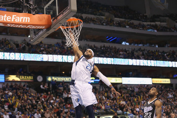 DALLAS, TX - DECEMBER 10:  Vince Carter #25 of the Dallas Mavericks makes the slam dunk against Marcus Thornton #23 of the Sacramento Kings at American Airlines Center on December 10, 2012 in Dallas, Texas.  NOTE TO USER: User expressly acknowledges and a