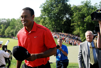 Any irony in this picture? Tiger Woods walking past the legendary Jack Nicklaus.