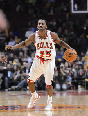Nov 28, 2012; Chicago, IL, USA; Chicago Bulls point guard Marquis Teague (25) dribbles the ball against the Dallas Mavericks during the second half at the United Center. The Chicago Bulls defeat the Dallas Mavericks 101-78. Mandatory Credit: Mike DiNovo-U
