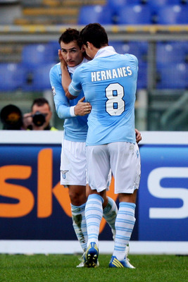 ROME, ITALY - DECEMBER 02:   Miroslav Klose (L) of SS Lazio is congratulated by team-mate Anderson Hernanes after scoring their team's second goal to equalise during the Serie A match between S.S. Lazio and Parma FC at Stadio Olimpico on December 2, 2012
