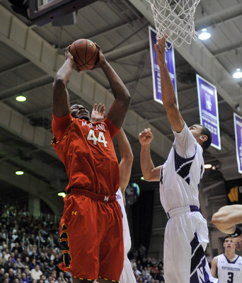 Nov 27, 2012; Evanston, IL, USA; Maryland Terrapins center Shaquille Cleare (44) is defended by Northwestern Wildcats guard Tre Demps (14)  during the first half at Welsh-Ryan Arena.  Mandatory Credit: David Banks-USA TODAY Sports