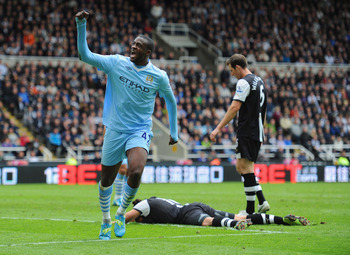 Yaya Toure celebrates scoring at St James' Park last season