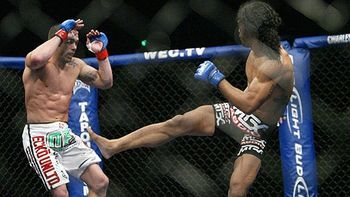 Ben Henderson delivered a perfect knee and jumped into a guillotine choke to become the WEC's undisputed lightweight champ. Photo c/o Sherdog.com.