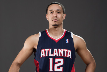 TARRYTOWN, NY - AUGUST 21:  John Jenkins #12 of the Atlanta Hawks poses for a portrait during the 2012 NBA Rookie Photo Shoot at the MSG Training Center on August 21, 2012 in Tarrytown, New York. NOTE TO USER: User expressly acknowledges and agrees that,