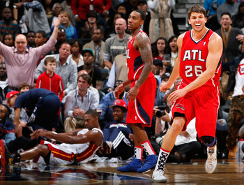 ATLANTA, GA - NOVEMBER 09:  Kyle Korver #26 of the Atlanta Hawks reacts after being called for a foul on Chris Bosh #1 of the Miami Heat at Philips Arena on November 9, 2012 in Atlanta, Georgia.  NOTE TO USER: User expressly acknowledges and agrees that,