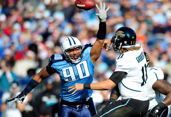 NASHVILLE, TN - DECEMBER 24:  Derrick Morgan #90 of the Tennessee Titans pressures a pass by Blaine Gabbert #11 of the Jacksonville Jaguars during play at LP Field on December 24, 2011 in Nashville, Tennessee.  (Photo by Grant Halverson/Getty Images)