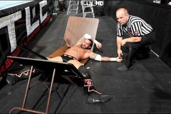 CM Punk after being put through a table at TLC 2011.