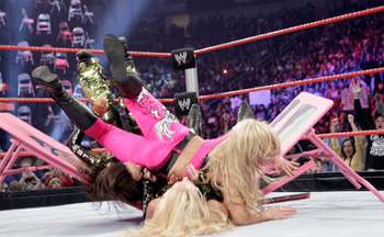 Natalya putting Lay-Cool through a table at TLC 2010. Photo: LethalWow.com