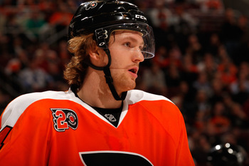 PHILADELPHIA, PA - MARCH 06: Sean Couturier #14 of the Philadelphia Flyers stakes on the ice against the Detroit Red Wings at Wells Fargo Center on March 6, 2012 in Philadelphia, Pennsylvania.  (Photo by Rob Carr/Getty Images)