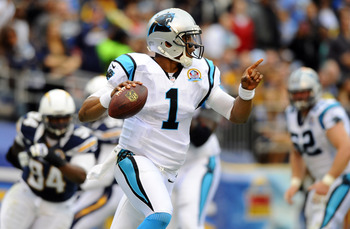 December 16, 2012; San Diego, CA, USA; Carolina Panthers quarterback Cam Newton (1) directs receivers during the first quarter against the San Diego Chargers at Qualcomm Stadium. Mandatory Credit: Christopher Hanewinckel-USA TODAY Sports