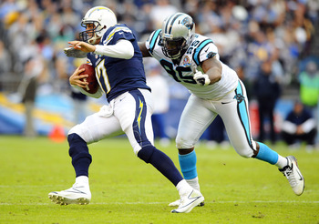 December 16, 2012; San Diego, CA, USA; San Diego Chargers quarterback Philip Rivers (17) is sacked by Carolina Panthers defensive end Charles Johnson (95) during the second quarter at Qualcomm Stadium. Mandatory Credit: Christopher Hanewinckel-USA TODAY S