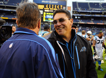 December 16, 2012; San Diego, CA, USA; Carolina Panthers head coach Ron Rivera talks with San Diego Chargers head coach Norv Turner after a 31-7 win by the Panters at Qualcomm Stadium. Mandatory Credit: Christopher Hanewinckel-USA TODAY Sports
