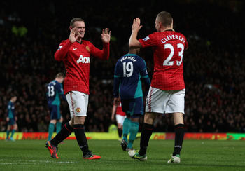 MANCHESTER, ENGLAND - DECEMBER 15:  Wayne Rooney of Manchester United is congratulated by Tom Cleverley of Manchester United after he scored the third goal during the Barclays Premier League match between Manchester United and Sunderland at Old Trafford o