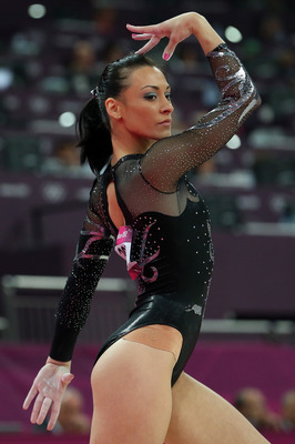 LONDON, ENGLAND - AUGUST 07:  Silver medalist Catalina Ponor of Romania competes in the Artistic Gymnastics Women's Floor Exercise final on Day 11 of the London 2012 Olympic Games at North Greenwich Arena on August 7, 2012 in London, England.  (Photo by R