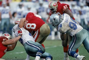 Steve Young (No. 8) getting sacked.