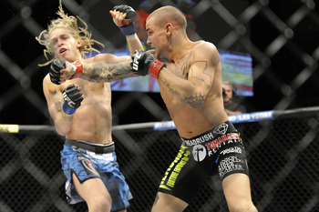 Poirier rocks Brookins before sinking in a choke.