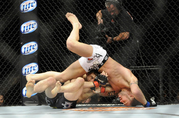Waldburger and Catone scramble during their TUF 16 finale contest.