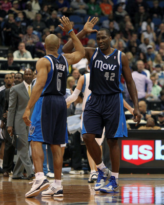 Dec 15, 2012; Minneapolis, MN, USA; Dallas Mavericks guard Derek Fisher (6) and Elton Brand (42) celebrate a play during the fourth quarter against the Minnesota Timberwolves at the Target Center. The Wolves defeated the Mavericks 114-106 in overtime. Man