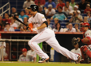 MIAMI, FL - SEPTEMBER 29:  Giancarlo Stanton #27 of the Miami Marlins follows through his home run against the Philadelphia Phillies  at Marlins Park on September 29, 2012 in Miami, Florida.  (Photo by Jason Arnold/Getty Images)