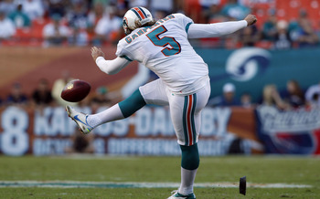 Dec 2, 2012; Miami Gardens, FL, USA;  Miami Dolphins kicker Dan Carpenter (5)  tries an on sides kick that is recovered by the New England Patriots in the fourth quarter at Sun Life Stadium. The Patriots defeated the Dolphins 23-16. Mandatory Credit: Robe