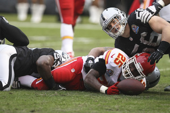 Dec 16, 2012; Oakland, CA, USA; Kansas City Chiefs running back Jamaal Charles (25) is brought down by Oakland Raiders middle linebacker Omar Gaither (53) and outside linebacker Miles Burris (56) during the third quarter at O.co Coliseum. The Oakland Raid