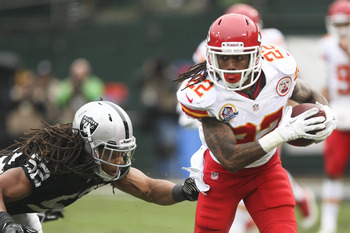 Dec 16, 2012; Oakland, CA, USA; Kansas City Chiefs wide receiver Dexter McCluster (22) carries the ball against Oakland Raiders outside linebacker Philip Wheeler (52) during the first quarter at O.co Coliseum.  Mandatory Credit: Kelley L Cox-USA TODAY Spo