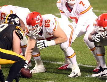 November 12, 2012; Pittsburgh, PA, USA; Kansas City Chiefs quarterback Matt Cassel (7) under center Ryan Lilja (65) awaiting the snap against the Pittsburgh Steelers during the second quarter at Heinz Field. The Pittsburgh Steelers won 16-13 in overtime. 