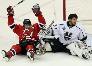 Patrik Elias (left) of the New Jersey Devils and Jonathan Quick of the Los Angeles Kings.