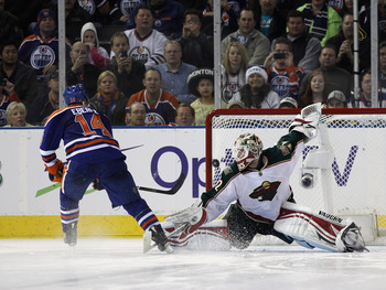 Niklas Backstrom (right) of the Minnesota Wild and Jordan Eberle of the Edmonton Oilers.