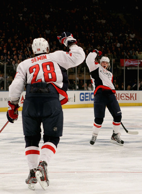 Alexander Semin (left), formerly of the Washington Capitals and John Carlson.