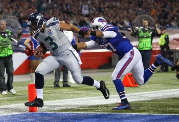 Russell Wilson scores one of his three first-half touchdowns.