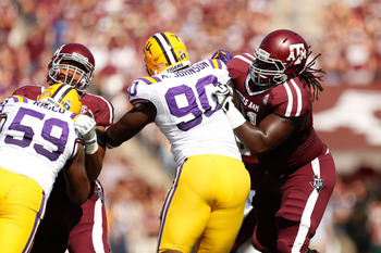 Aggie center Patrick Lewis blocks against LSU