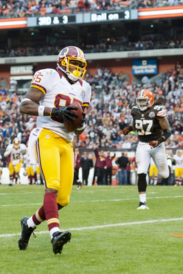 CLEVELAND, OH - DECEMBER 16: Wide receiver Leonard Hankerson #85 of the Washington Redskins runs in a touchdown during the second half against the Cleveland Browns at Cleveland Browns Stadium on December 16, 2012 in Cleveland, Ohio. The Redskins defeated