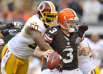 Dec 16, 2012; Cleveland, OH, USA; Washington Redskins outside linebacker Rob Jackson (50) sacks Cleveland Browns quarterback Brandon Weeden (3) in the fourth quarter at Cleveland Browns Stadium. Mandatory Credit: David Richard-USA TODAY Sports