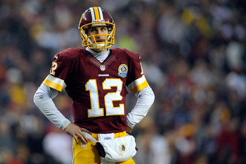 LANDOVER, MD - DECEMBER 09:  Kirk Cousins #12 of the Washington Redskins reacts during the fourth quarter against the Baltimore Ravens at FedExField on December 9, 2012 in Landover, Maryland.  (Photo by Patrick McDermott/Getty Images)