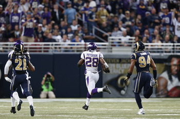 ST. LOUIS, MO - DECEMBER 16: Adrian Peterson #28 of the Minnesota Vikings rushes for an 82-yard touchdown in the first half against the St. Louis Rams during the game at Edward Jones Dome on December 16, 2012 in St. Louis, Missouri. The Vikings won 36-22.