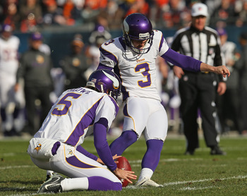 CHICAGO, IL - NOVEMBER 25:  Blair Walsh #3 of the Minnesota Vikings kicks a field goal out of the hold of Chris Kluwe #5 against the Chicago Bears at Soldier Field on November 25, 2012 in Chicago, Illinois. The Bears defeated the Vikings 28-10.  (Photo by