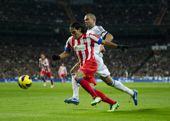 Falcao doing battle with Real Madrid defender Pepe