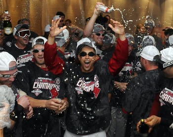 The Washington Nationals celebrate winning the 2012 NL East title. With the Nationals, Atlanta Braves and Philadelphia Phillies chasing the division crown, it will be a while before the Marlins can think about winning.