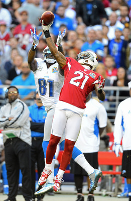 Peterson battles Calvin Johnson for the ball.