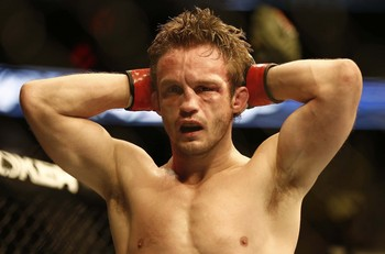 Aug 17, 2013; Boston, MA, USA; Brad Pickett looks on after his loss of a UFC bantamweight match at the TD Garden. Michael McDonald won by a tap out. Mandatory Credit: Winslow Townson-USA TODAY Sports