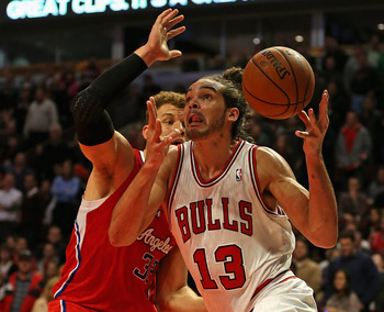 CHICAGO, IL - DECEMBER 11: Joakim Noah #13 of the Chicago Bulls drives past Blake Griffin #32 of the Los Angeles Clippers at the United Center on December 11, 2012 in Chicago, Illinois. The Clippers defeated the Bulls 94-89. NOTE TO USER: User expressly a