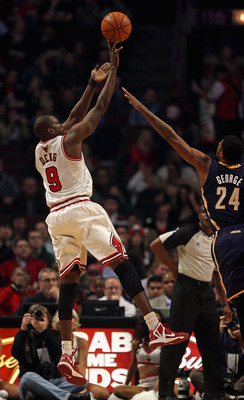 CHICAGO, IL - DECEMBER 04:  Loul Deng #9 of the Chicago Bulls shoots over Paul George #24 of the Indiana Pacers at the United Center on December 4, 2012 in Chicago, Illinois. The Pacers defeated the Bulls 80-76. NOTE TO USER: User expressly acknowledges a