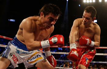 Jorge Arce, left, felt the right hand of Nonito Donaire in this round as well as the left later on.