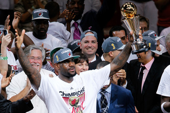 LeBron James celebrates winning his first NBA championship and NBA Finals MVP.