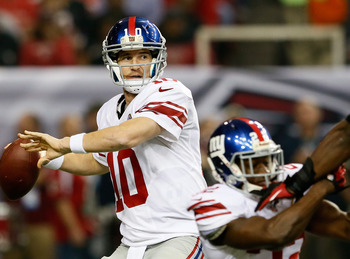ATLANTA, GA - DECEMBER 16:  Eli Manning #10 of the New York Giants looks to pass against the Atlanta Falcons at Georgia Dome on December 16, 2012 in Atlanta, Georgia.  (Photo by Kevin C. Cox/Getty Images)